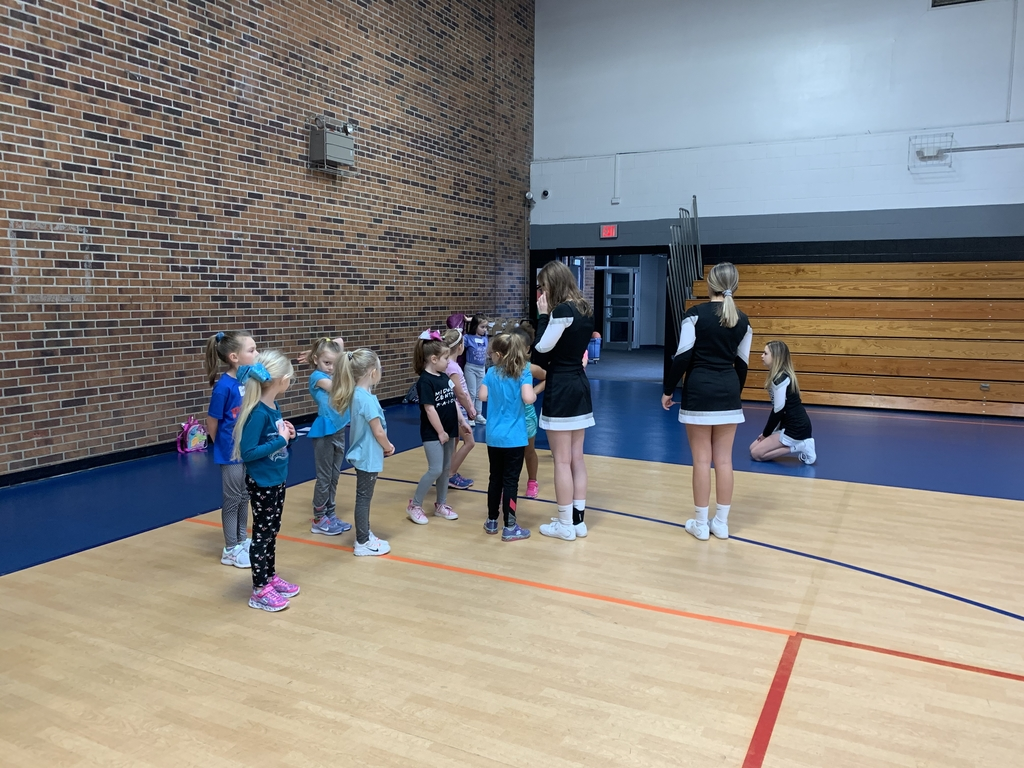 Kindergarten learning a cheer.